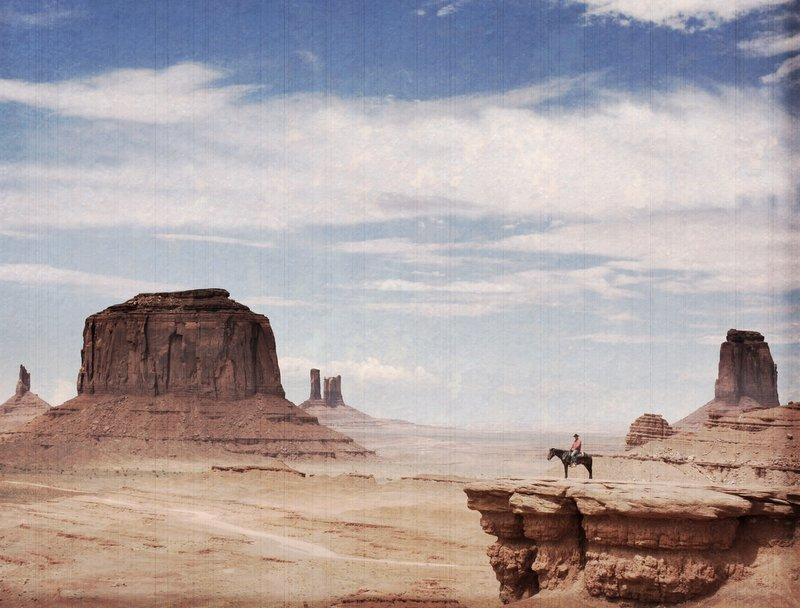Man on horse in the desert