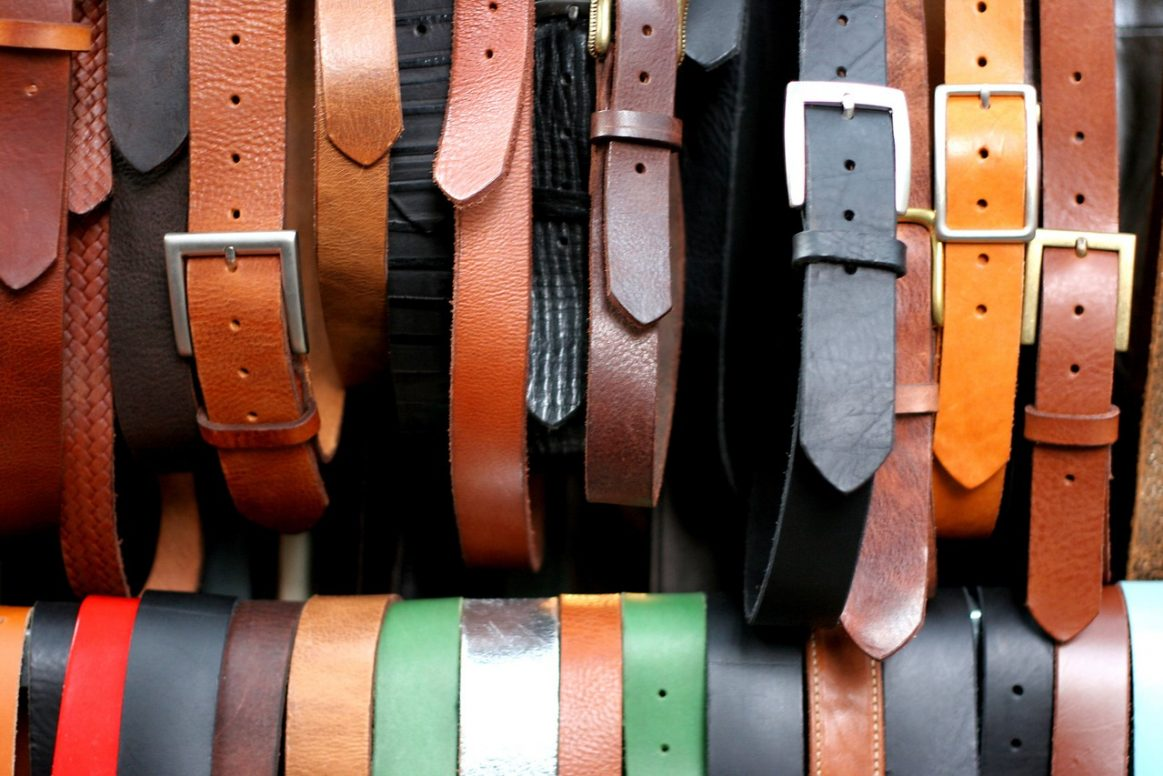 Different colour leather belts on display